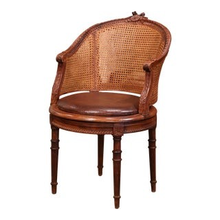 19th Century French Carved Walnut and Cane Swivel Desk Armchair With Leather For Sale