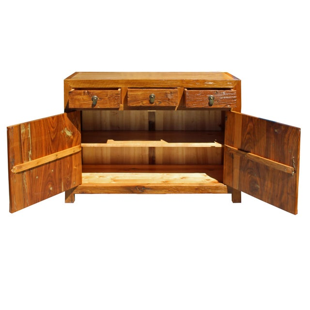 This is a console sideboard cabinet with oriental simple metal hardware as an accent. The surface is finished with a...