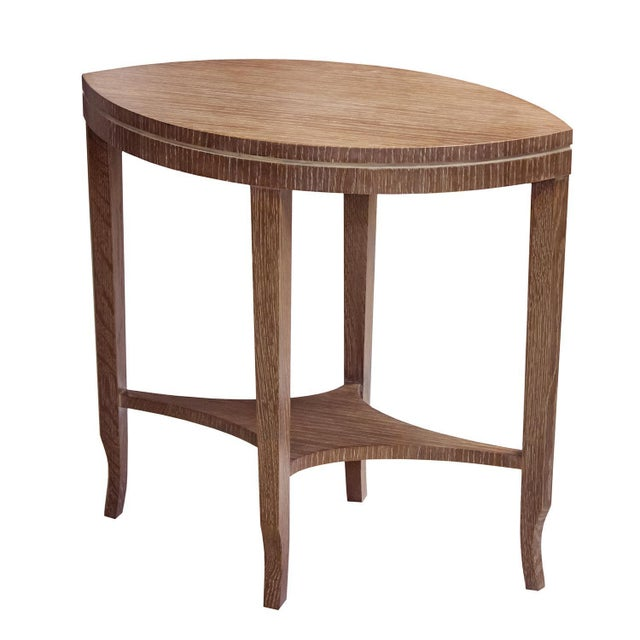 The graceful sweeping lines of the top and arched stretcher make this eye-catching table appealing in any setting. This...
