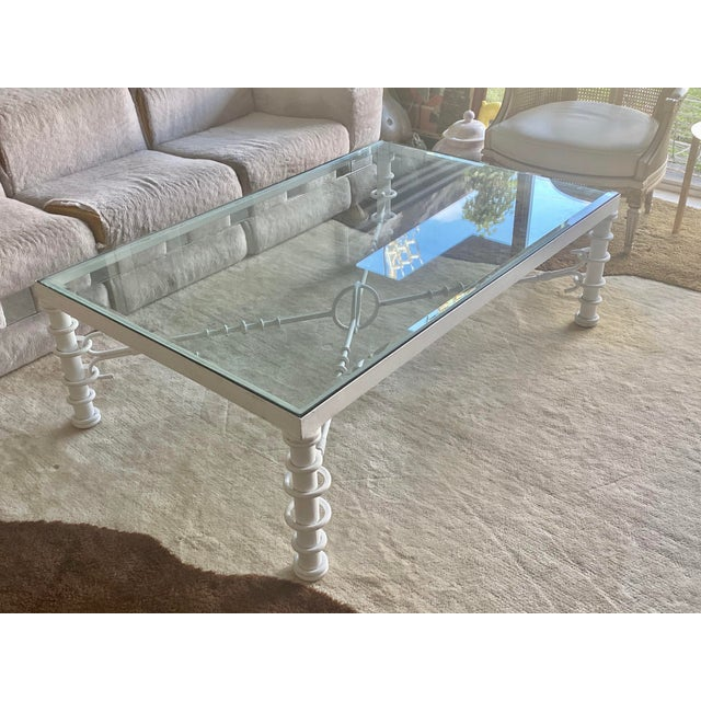 Giacometti style coffee table with glass top. In very good condition.