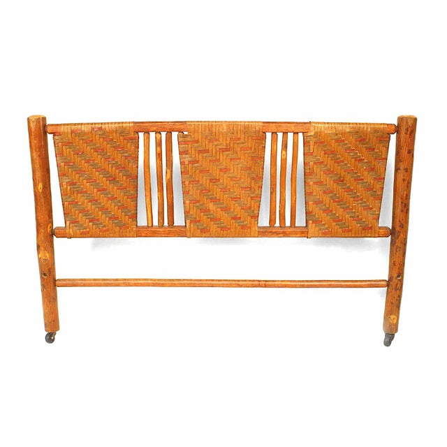 Crafted by the Columbus Hickory Furniture Co, a rustic American full-sized headboard composed of woven panels.