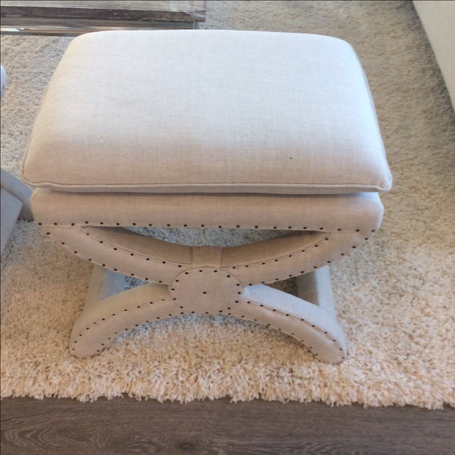 Sand linen cross stool with nail heads from Restoration Hardware. In mint condition. Used in model home staging only, no...