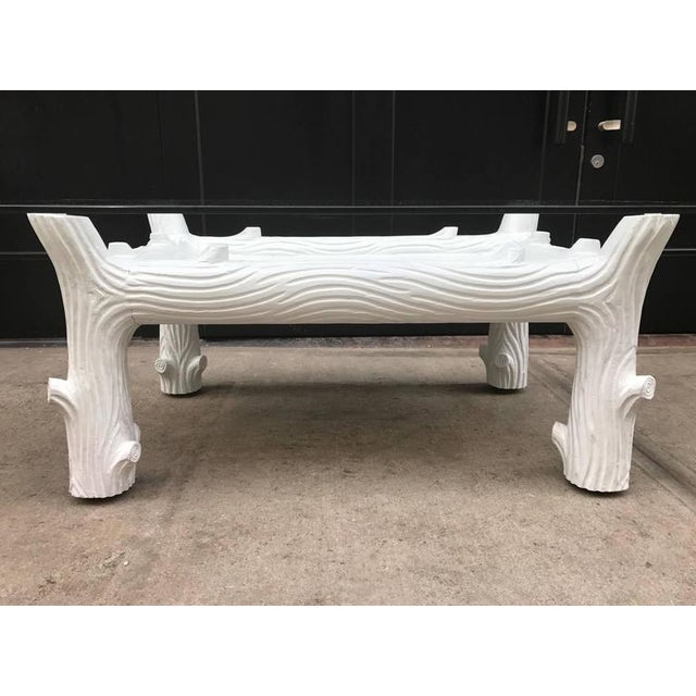 White vintage wood coffee table manner of John Dickinson. Base is wood with a white painted finish. Measurements listed is...