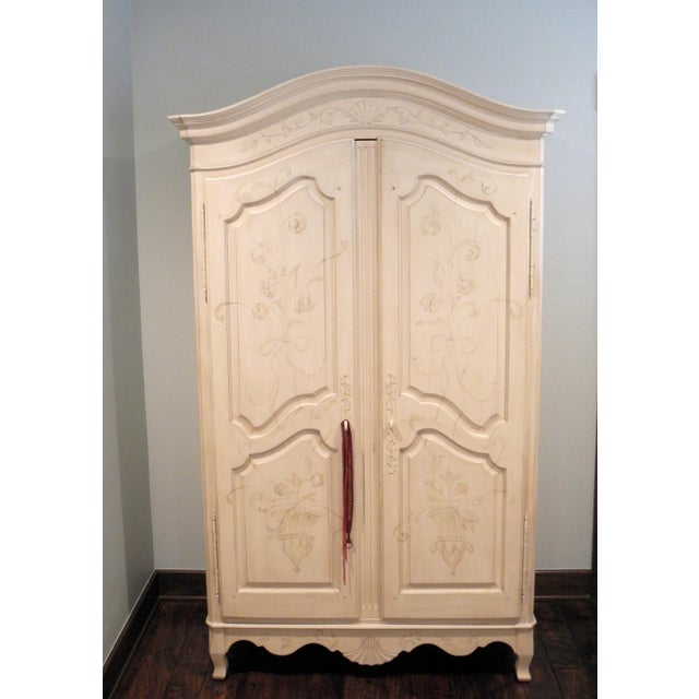 Hand painted Maison Armoire purchased 2007 from Ethan Allen. 6 drawers inside and hanging space.