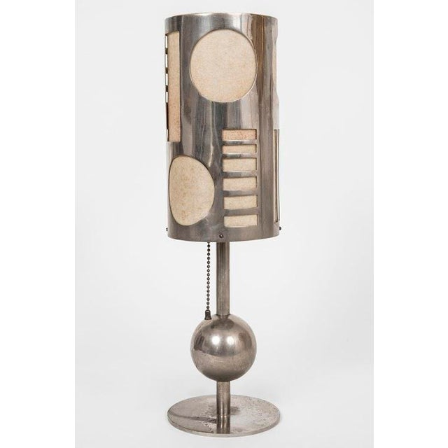 Rare modernist Karl Hagenhauer nickel plated table lamp with cut out geometrical motifs. Signed.