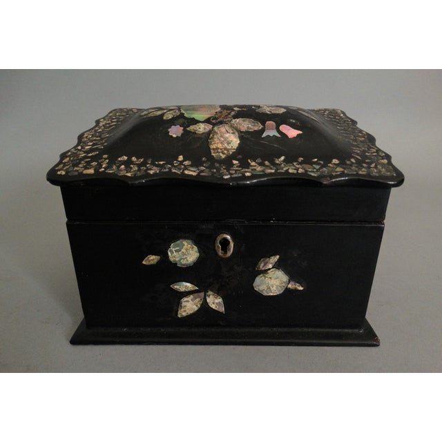 A late-19th-century English Victorian lacquered papier mache box with lovely mother-of-pearl inlay. Features sloped lid...