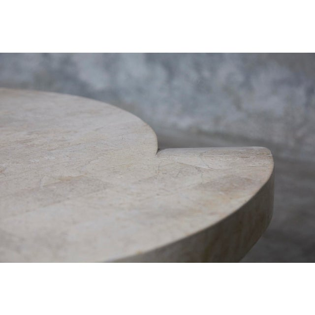 Dynamic cocktail or coffee table completely hand-inlaid with beige Cantor stone. All natural stone with no lacquer or...