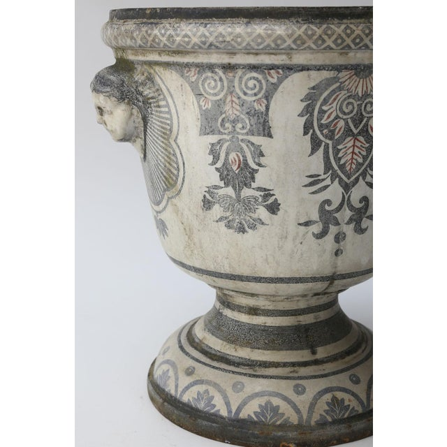Enameled Cast Iron Rouen Urn decorated in blue and red on white colors. This 19th century enameled urn is relatively large...
