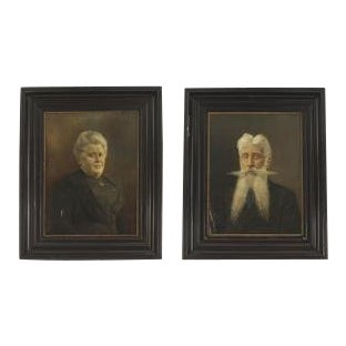 Pair of ebonized framed oil painting portraits of lady with hair up and man with long beard For Sale