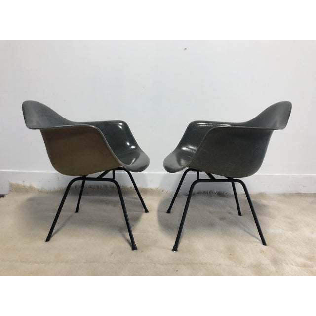 Pair of Early Eames Herman Miller Armchairs, Elephant Hide Grey Very well-preserved examples. One small stable edge rack;...