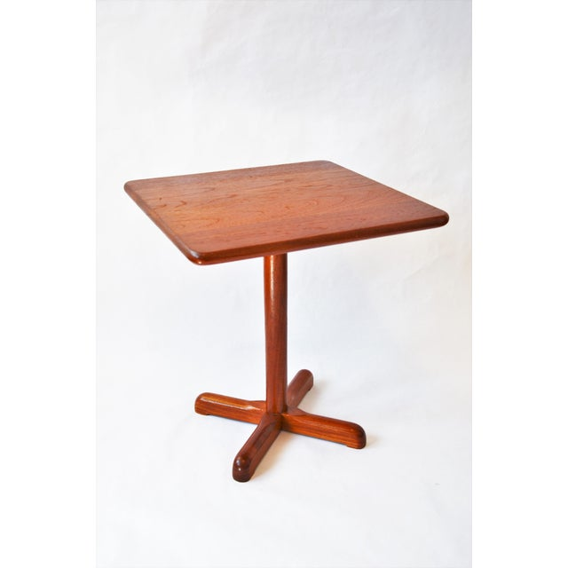 A great small scale vintage Scandinavian Mid-Century Modern solid teak side table with pedestal base. Could be used as a...
