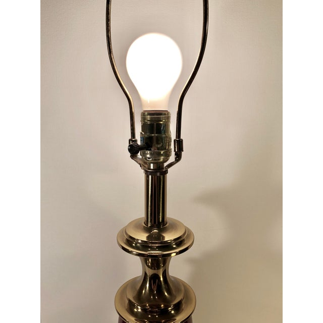 Brass And Wine Colored Porcelain Stiffel Lamp