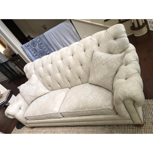 Hand-tailored Ethan Allan Tufted Fabric Chadwick Sofa with a very detailed touch of light floral pattern and nailhead trim...