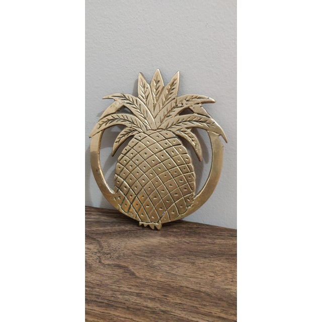 Up for sale is a brass pineapple trivet! Brass is in fairly good shape with wear consistent with the nature of the item.