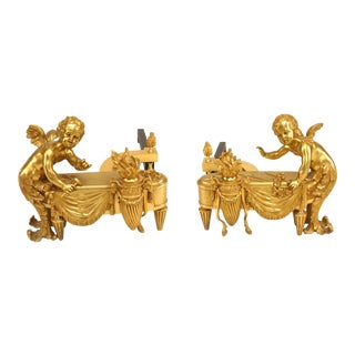Louis XVI Bronze Cupid Andirons - a Pair For Sale