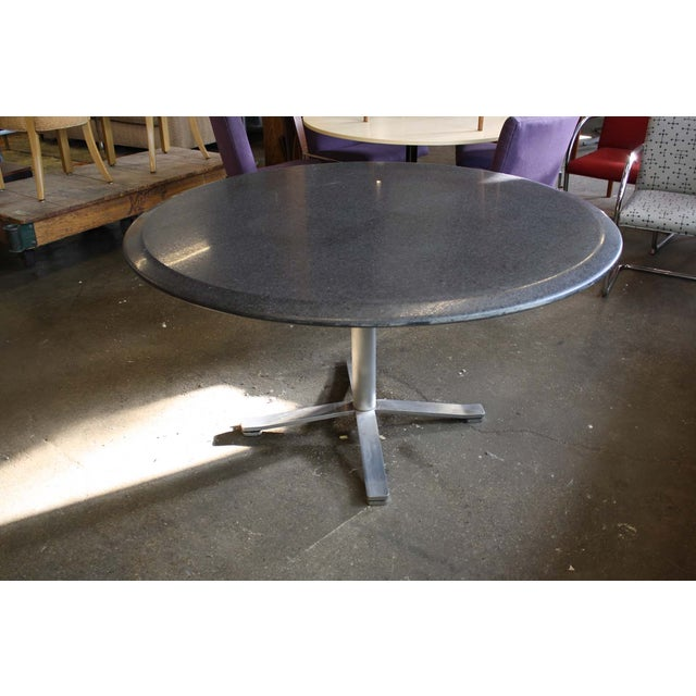 A Zographos pedestal table from the Mid-Century, with elegant yet industrial lines and a timeless style. Impeccably...