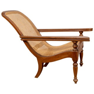 Antique Dutch Colonial Plantation Lounge Chair With Curving Seat and Rattan Seat For Sale