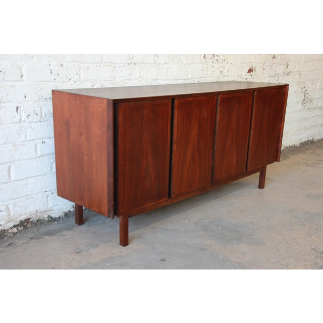 Offering a very nice mid-century modern credenza or sideboard by Merton Gershun for Dillingham. This was walnut credenza...