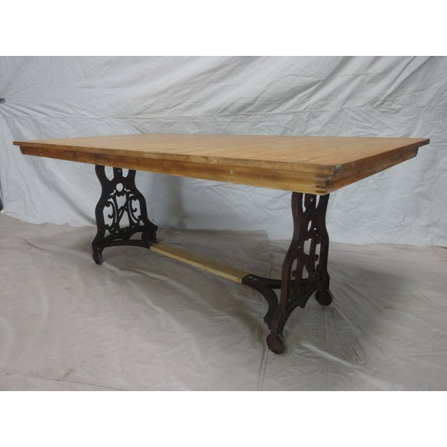 This dining table's iron base was originally part of an industrial sewing machine found at an estate auction in Leksand,...