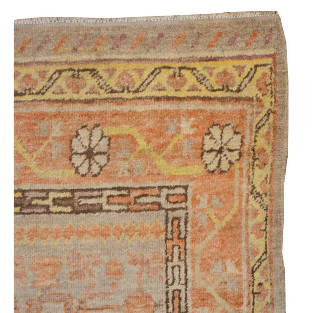An early 20th century Central Asian Samarkand rug with an all-over pomegranate pattern on a faded indigo background,...