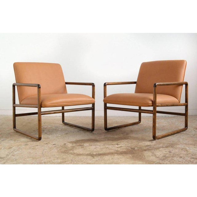 This pair of elegant, understated lounge chairs by Ward Bennet epitomize his design aesthetic: combining a refined...