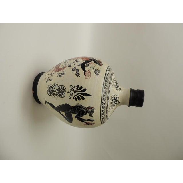 Vintage encaustic hand painted terracotta Greek water jug with handle. Tall hand painted jar depicting traditional Greek...