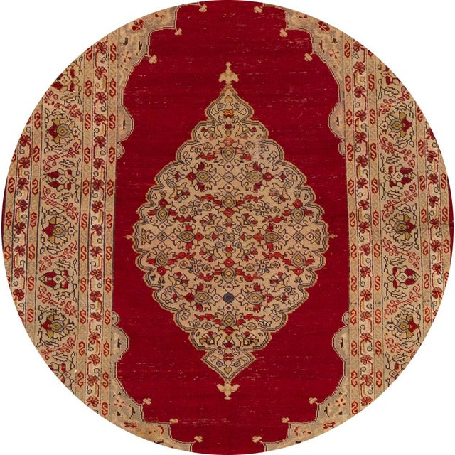 A beautiful antique Persian Kerman rug with a tan field, and multi-color accents in an all-over geometric design. This rug...