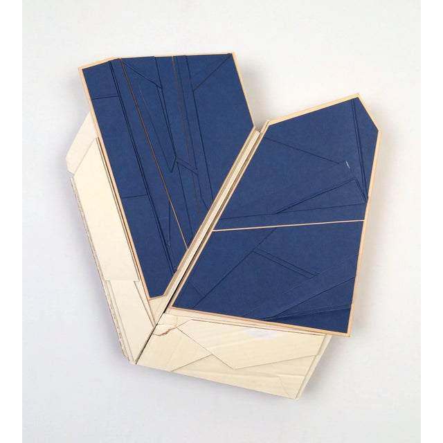 """AGENCY, 2017 found (unpainted) cardboard, cut book cover, foamcore 17 x 15 x 2 in. """"My creative practice is intuitive and..."""