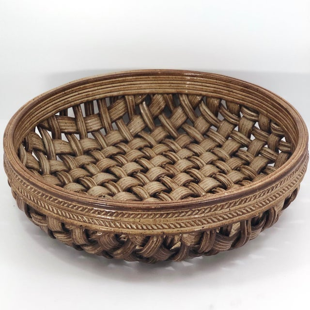 This huge basketweave pottery bowl or platter would be the perfect thing to place on a entryway table or on the kitchen...