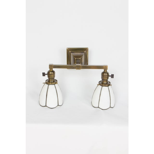 Pair of Arts and Crafts sconces with white slag glass shades. Can be mounted with shades facing down or up. Completely...
