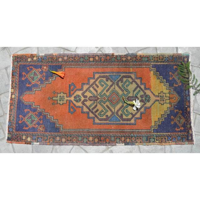 a Vintage Turkish Small yastik rug, degarded contessa - chenin background color yastik rug perfect for entryway, bath or...