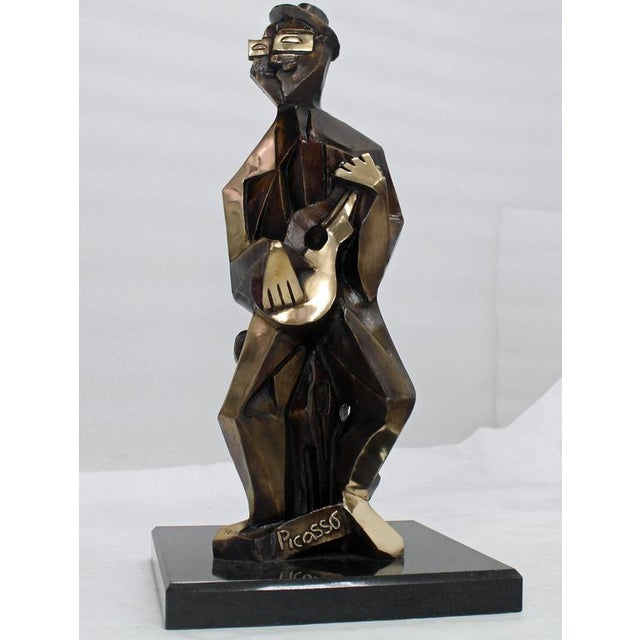 """Very nice heavy solid bronze sculpture of a man playing guitar on square granite base. Measures: 19"""" tall."""