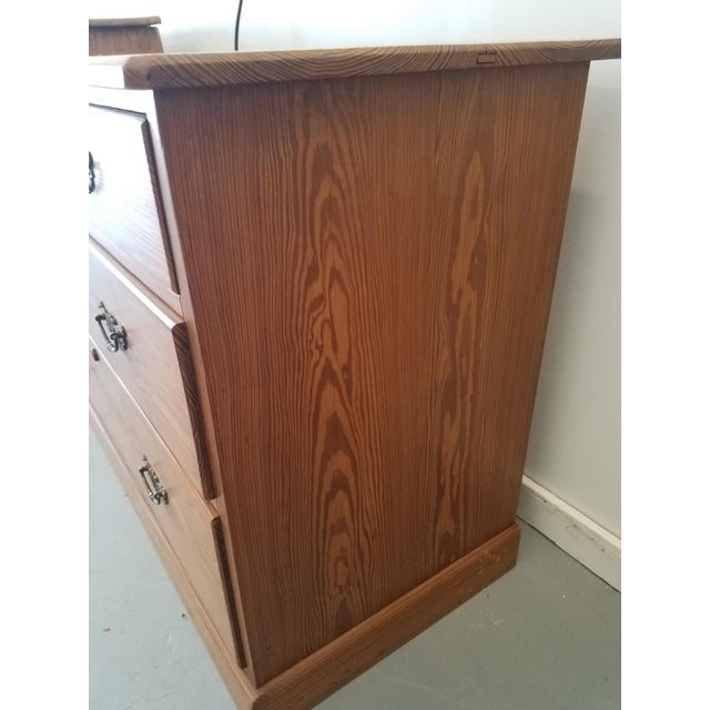 United Kingdom Pitch Pine Two Drawers Over Two Drawers Chest of Drawers. Pitch pine shows the grain and it is a heavy pine.
