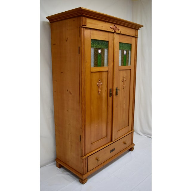 This is a handsome and extremely well built German armoire from the early twentieth century, employing all hand-cut...