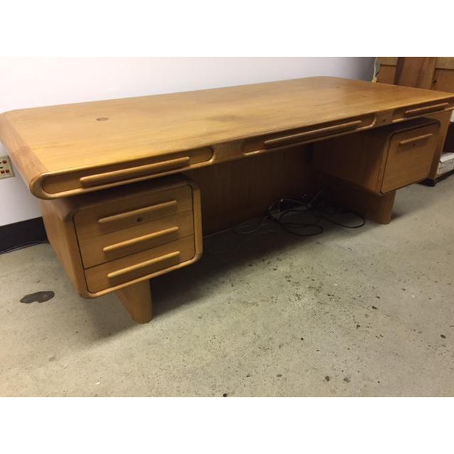 Large Scan Design Teak desk designed by Kibaek Mobelfabrik out of Denmark. Drawers are all lockable. It is modular for...