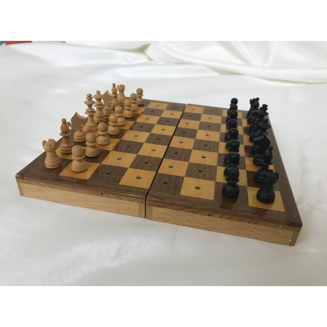 Excellent vintage miniature traveling chess set. Folds and carries chess pieces for easy storage.