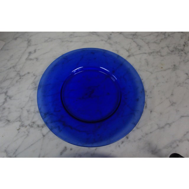 Set of six transparent cobalt blue lunch plates hand made by blown glass. Very modern style. Great for decorating a...