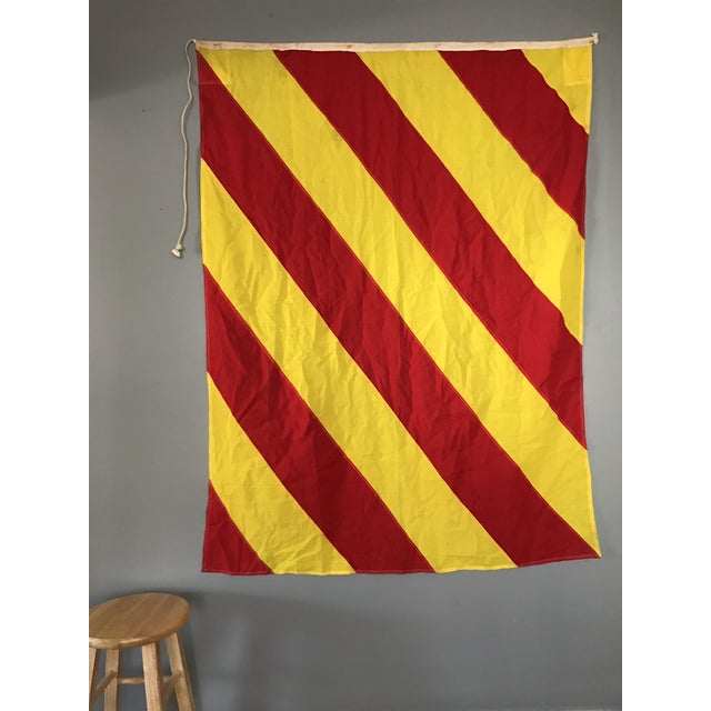 This large vintage maritime flag has some wear with age, but has maintained its bright red and yellow wool fabric. This...