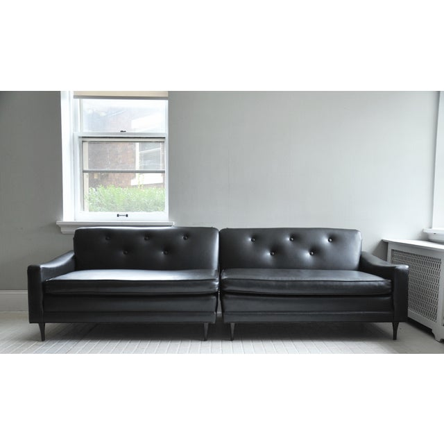 Really fantastic, black vinyl, tufted, 2 piece sectional from the 1960's. In superb conditional for age. From pet free and...
