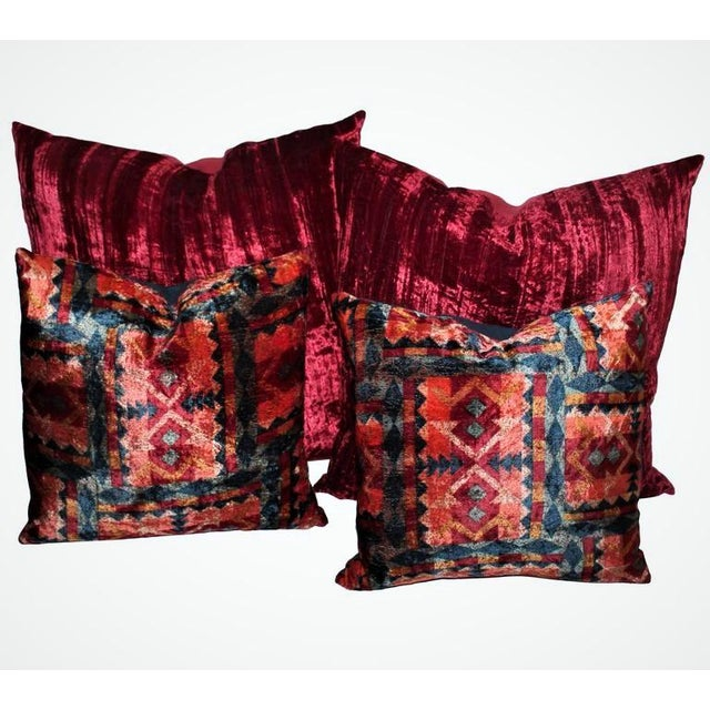 These vintage red silk velvet pillows have red cotton linen backings. There are two pairs in stock. The smaller patterned...