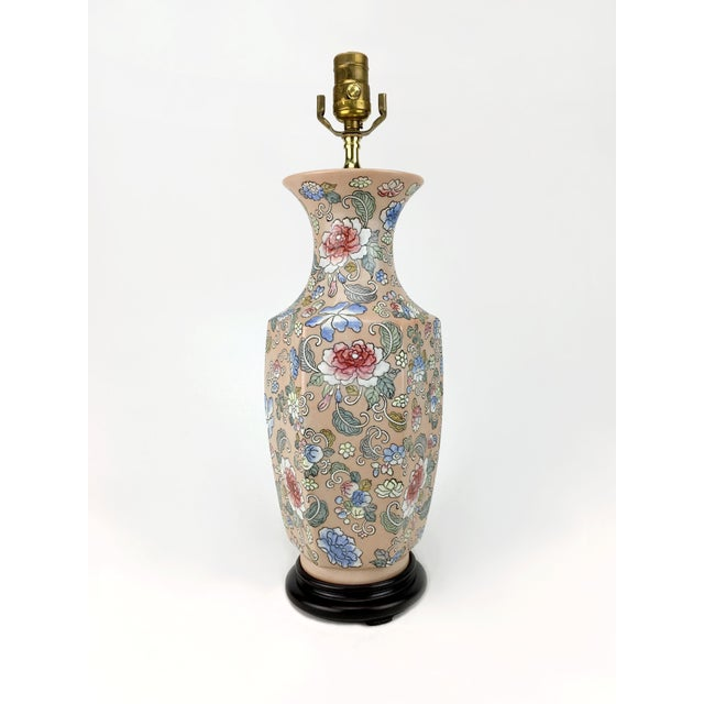 Beautiful vase lamp featuring traditional Chinese style illustration motif of peonies and other blossoms. Blooms painted...