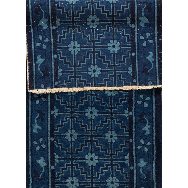 Apadana - Antique Chinese Peking runner rug. This piece has a dark blue field with a lighter blue, geometric all-over...