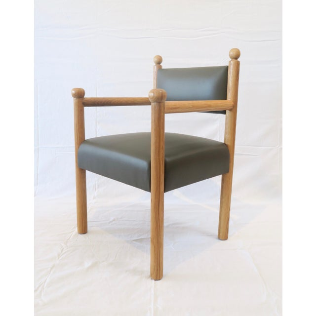 "Custom Dining Chair in Scrubbed Oak finish with finial details. Upholstered in Brown/Green Faux Leather. Seat is 17""H"