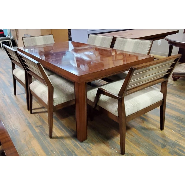 Sale includes one complete dining table with one leaf, four wide body side chairs and two wide body arm chairs. Venue by...