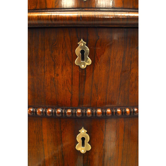 English Regency style rosewood Gothic design chest of drawers with pagoda mirror top, circa 1840.