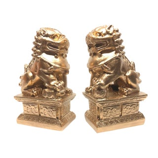 Golden Foo Guardians Chinoiserie Statues - A Pair For Sale