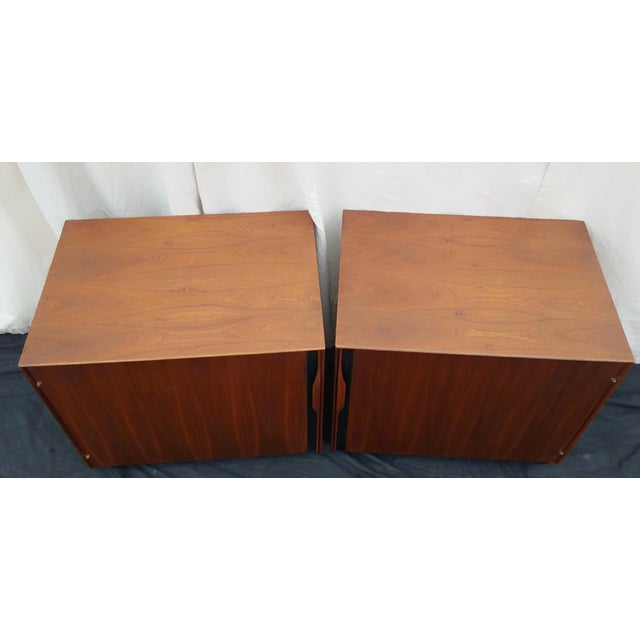 Pair of nightstands or living room side tables. Designed by John Kapel for Glenn of California. Verticle sculpted cabinet...