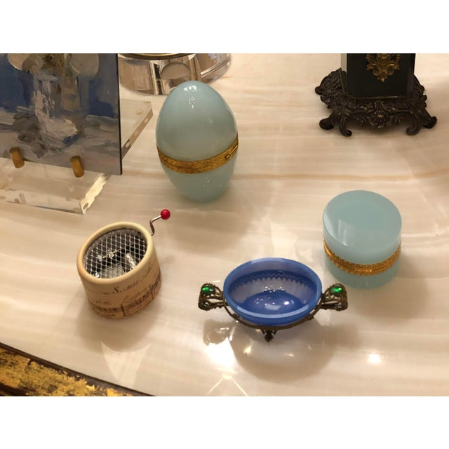 A blue opaline dish with ormolu handles and surround and green inset cabochons. Circa 1900 from France.