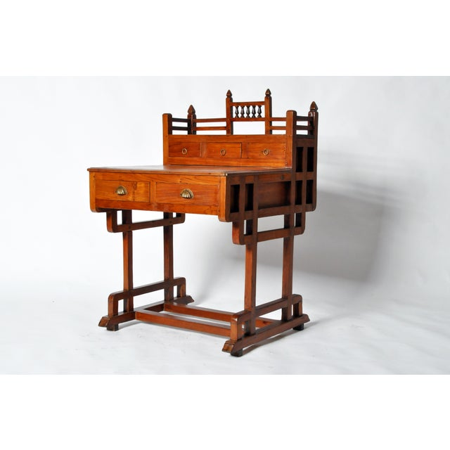 This elegant Art Deco desk if from Gujarat, India and is made from Teakwood, circa 1950. It features five drawers for...