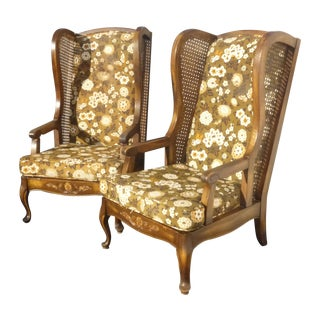 Midcentury Cane Wing Back Floral Arm Chairs - Pair For Sale